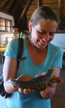 Holding Crocodile Baby